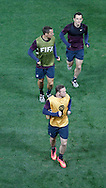 Wayne Rooney of England (bottom), Phil Jagielka of England (middle) and Leighton Baines of England warm up during the England training session at Arena Corinthians, Sao Paulo, Brazil, on the eve of their World Cup 2014 Group D match against Uruguay.<br /> Picture by Andrew Tobin/Focus Images Ltd +44 7710 761829<br /> 18/06/2014