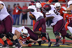 15 October 2016:  Dalton Keene reaches for he foot of D.J. Davis. NCAA FCS Football game between Southern Illinois Salukis and Illinois State Redbirds at Hancock Stadium in Normal IL (Photo by Alan Look)