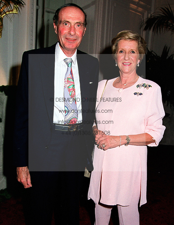 LORD & LADY FAIRHAVEN at a party in London on 26th May 1999.MSN 129