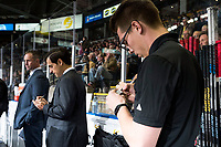 KELOWNA, CANADA - SEPTEMBER 29: Equipment manager Chaydyn Johnson marks the game puck of the first WHL goal of Libor Zabransky #7 of the Kelowna Rockets on September 29, 2017 at Prospera Place in Kelowna, British Columbia, Canada.  (Photo by Marissa Baecker/Shoot the Breeze)  *** Local Caption ***
