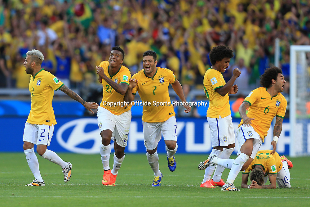 28th June 2014 - FIFA World Cup - Round of 16 - Brazil v Chile - Jo of Brazil (2L) and Hulk of Brazil (C) celebrate with teammates after their shootout victory - Photo: Simon Stacpoole / Offside.