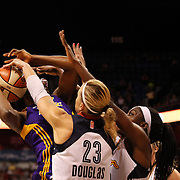 Nneka Ogwumike, Los Angeles Sparks, (wearing face mask), is fouled while shooting by sister Chiney Ogwumike, (right) and Katie Douglas, Connecticut Sun, during the Connecticut Sun Vs Los Angeles Sparks WNBA regular season game at Mohegan Sun Arena, Uncasville, Connecticut, USA. 3rd July 2014. Photo Tim Clayton
