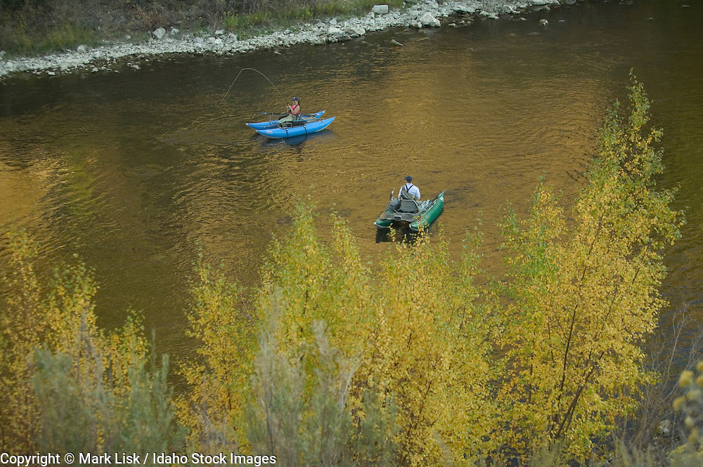 (MR) Warm autumn sun warms fly fisherman in the South Fork of the Boise River canyon, Idaho.