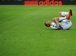 Real Madrid's Cristiano Ronaldo lies injured in front of an Adidas advert - Photo mandatory by-line: Joe Meredith/JMP - Mobile: 07966 386802 12/08/2014 - SPORT - FOOTBALL - Cardiff - Cardiff City Stadium - Real Madrid v Sevilla - UEFA Super Cup