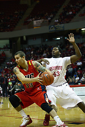 11 December 2010: Shawn King battles to get to the lane against Austin Hill  during an NCAA basketball game between the Illinois - Chicago Flames (UIC) and the Illinois State Redbirds (ISU) at Redbird Arena in Normal Illinois.