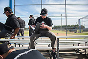 Eric Johnson studies the notes he's written down during a break at the Wendelstedt Umpire School in Daytona Beach, Fla.