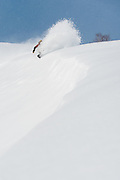 Alex Yoder lays into a long frontside wave in the Moiwa backcountry. Niseko, Hokkaido, Japan.