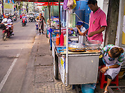 "04 OCTOBER 2012 - BANGKOK, THAILAND: A row of street food stands on Sukhumvit Soi 22 in central Bangkok. Thailand in general, and Bangkok in particular, has a vibrant tradition of street food and ""eating on the run."" In recent years, Bangkok's street food has become something of an international landmark and is being written about in glossy travel magazines and in the pages of the New York Times.       PHOTO BY JACK KURTZ"