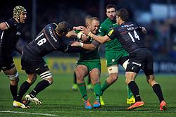 Shane Geraghty of London Irish is tackled by Brett Sharman and Chris Wyles of Saracens - Photo mandatory by-line: Patrick Khachfe/JMP - Mobile: 07966 386802 03/01/2015 - SPORT - RUGBY UNION - London - Allianz Park - Saracens v London Irish - Aviva Premiership
