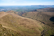 Dramatic landscape view from the summit of Pen Y Fan down the steep incline across the valleys of Brecon Beacons National Park, Wales, Powys, United Kingdom.  Pen Y Fan is the highest point in the Brecon Beacons hill and mountain range in South Wales. The National Park was established in 1957 due to the spectacular landscape which is rich in natural beauty and is run by the National Trust.  (photo by Andrew Aitchison / In pictures via Getty Images)