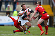 Bradford Bulls centre Lee Smith (1) is tackled during the Kingstone Press Championship match between Dewsbury Rams and Bradford Bulls at the Tetley's Stadium, Dewsbury, United Kingdom on 10 September 2017. Photo by Simon Davies.