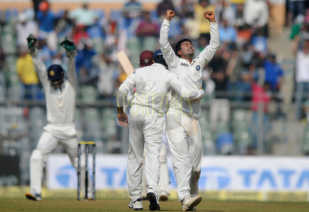 Pragyan Ojha of India celebrates the wicket of Shane Shillingford of West Indies during day one of the second Star Sports test match between India and The West Indies held at The Wankhede Stadium in Mumbai, India on the 14th November 2013<br /> <br /> This test match is the 200th test match for Sachin Tendulkar and his last for India.  After a career spanning more than 24yrs Sachin is retiring from cricket and this test match is his last appearance on the field of play.<br /> <br /> Photo by: Pal PIllai - BCCI - SPORTZPICS<br /> <br /> Use of this image is subject to the terms and conditions as outlined by the BCCI. These terms can be found by following this link:<br /> <br /> http://sportzpics.photoshelter.com/gallery/BCCI-Image-Terms/G0000ahUVIIEBQ84/C0000whs75.ajndY