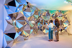 Sharjah, UAE. 20 December 2018. Modern Islamic art is presented at the  21st Islamic Arts Festival which opened this week in Sharjah, UAE.  The festival runs until 19 January 2019 and features work by International artists at various locations across the city. Pictured; Sculpture Prism Wall by Kaz Shirana