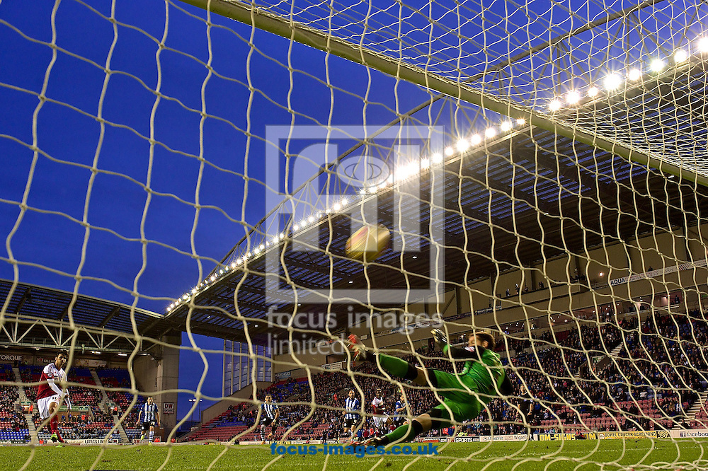 Bryan Ruiz of Fulham (left) scores their third goal from a penalty to make it Wigan Athletic 3 Fulham 3 during the Sky Bet Championship match at the DW Stadium, Wigan<br /> Picture by Ian Wadkins/Focus Images Ltd +44 7877 568959<br /> 01/11/2014