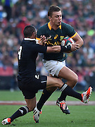 JOHANNESBURG, South Africa, 04 October 2014 : Handré Pollard of the Springboks is tackled by Aaron Smith of the All Blacks during the Castle Lager Rugby Championship test match between SOUTH AFRICA and NEW ZEALAND at ELLIS PARK in Johannesburg, South Africa on 04 October 2014. <br /> The Springboks won 27-25 but the All Blacks successfully defended the 2014 Championship trophy.<br /> <br /> © Anton de Villiers / SASPA