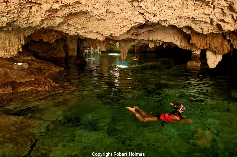 Snorkeling in a cenote on the Riviera Maya, Mexico