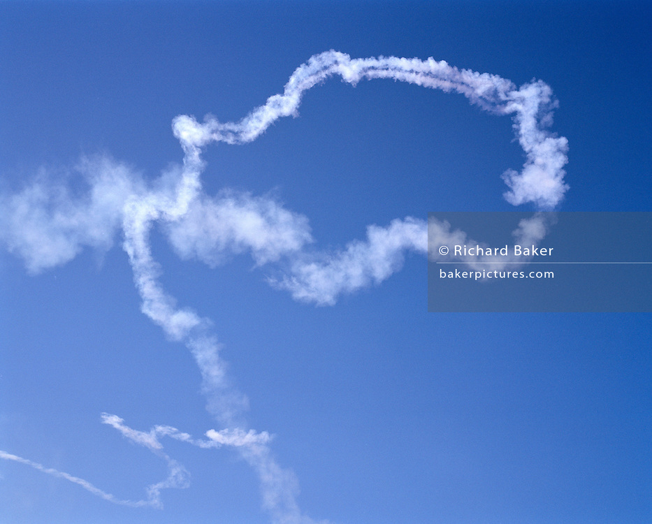 White smoke left in summer skies by the 'Red Arrows', Britain's Royal Air Force aerobatic team.