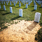 A fresh gravesite of a fallen soldier from Operation Enduring Freedom in Afghanistan is pictured on Saturday, July 25, 2009 at Arlington National Cemetery in Arlington, VA.