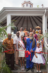 "The red ribbon is cut to officially open the 2016 Annual Food Fair.  The Festival & Cultural Organization of St. John Presents It's Annual Food Fair honoring Delroy ""Ital"" Anthony and Royal Coronation 2016.  Franklin A. Powell, Sr. Park.  St. John, US Virgin Islands.  26 June 2016.  © Aisha-Zakiya Boyd"