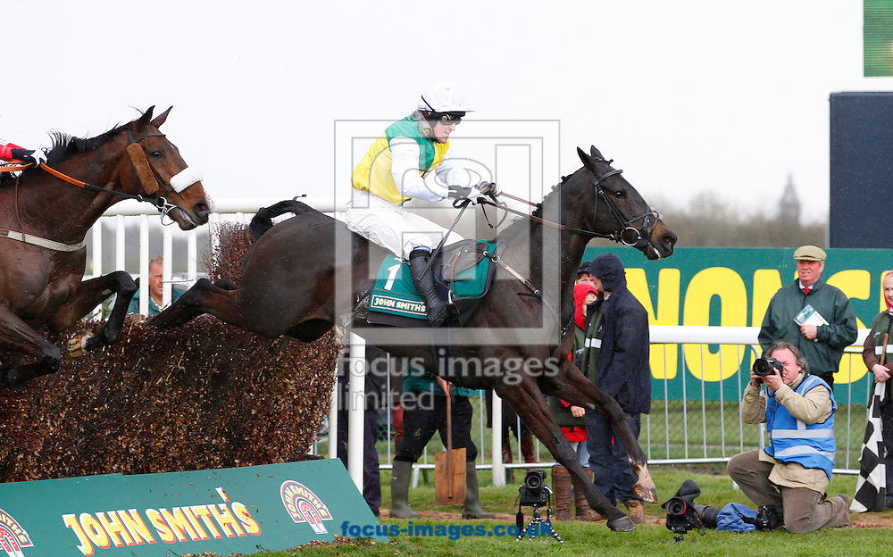Picture by John Hoy/Focus Images Ltd. 07583422396.13/03/12.A P McCoy and Albertas Run jumping the last in the home straight in front of the photographers in The John Smith's Melling Chase at Aintree, Liverpool.