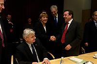 14 DEC 2003, BERLIN/GERMANY:<br /> Joschka Fischer, B90/Gruene, Bundesaussenminister, Angela Merkel, CDU Bundesvorsitzende, Henning Scherf, SPD, 1. Buegermeister Bremen, und Gerhard Schroeder, SPD, Bundeskanzler, (v.L.n.R.), begruessen sich, vor Beginn der Sitzung des Vermittlungsausschusses, Bundesrat<br /> IMAGE: 20031214-01-075<br /> KEYWORDS: Gespräch, Gespraech, Gerhard Schröder, Begruessung, Begrüssung, Handshake