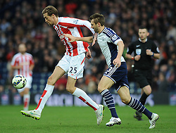 West Bromwich Albion's Gareth McAuley closes down Stoke City's Peter Crouch - Photo mandatory by-line: Dougie Allward/JMP - Mobile: 07966 386802 - 14/03/2015 - SPORT - Football - Birmingham - The Hawthorns - West Bromwich Albion v Stoke City - Barclays Premier League