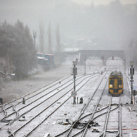 A wintry scene as a ScotRail train approaches Perth Railway station this morning after overnight snow and ice which continued to fall into the day...27.12.14<br /> Picture by Graeme Hart.<br /> Copyright Perthshire Picture Agency<br /> Tel: 01738 623350  Mobile: 07990 594431