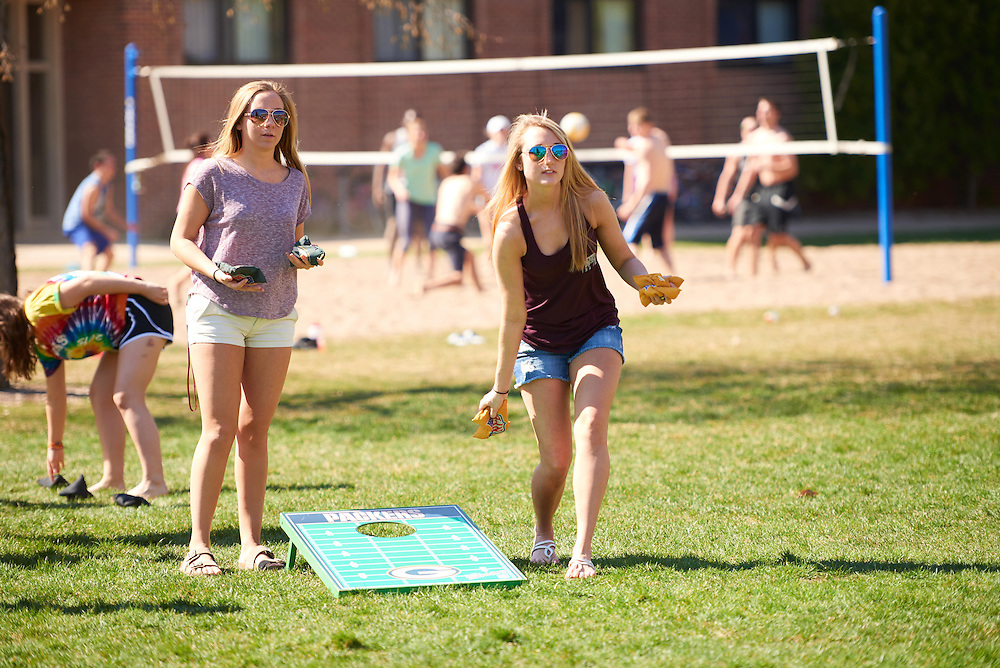 Activity; Socializing; Playing; Buildings; Eagle Hall; Location; Outside; People; Student Students; Spring; April; Time/Weather; sunny; Type of Photography; Candid; UWL UW-L UW-La Crosse University of Wisconsin-La Crosse; Woman Women