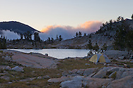 At sunrise, a cloud bank moves up out of the valley to the east of Glacier Lake, catching the first rays of sunlight, Eagle Cap Wilderness, Oregon