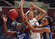 Arkansas Democrat-Gazette/BENJAMIN KRAIN --12/13/15--<br /> UALR's Amber Landing fights for a rebound against Tulsa's Tyjae Scales and Ashley Clark during the Lady Trojan's loss Sunday in Little Rock.