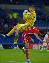 CARDIFF, WALES - Monday, September 9, 2019: Belarus' goalkeeper Alyaksandr Hutar and Wales' captain Joe Allen during the International Friendly match between Wales and Belarus at the Cardiff City Stadium. (Pic by Mark Hawkins/Propaganda)