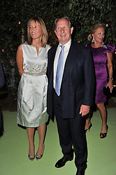 PADDY McNALLY and SARAH TYZACK at a dinner hosted by Cartier in celebration of the Chelsea Flower Show held at Battersea Power Station, 188 Kirtling Street, London SW8 on 23rd May 2011.