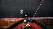 The crew of a Moran tug boat works an MSC container ship, Thursday, Nov. 6, 2014, on the Savannah River  to the Garden City Terminal near Savannah, Ga.  (GPA Photo/Stephen B. Morton)