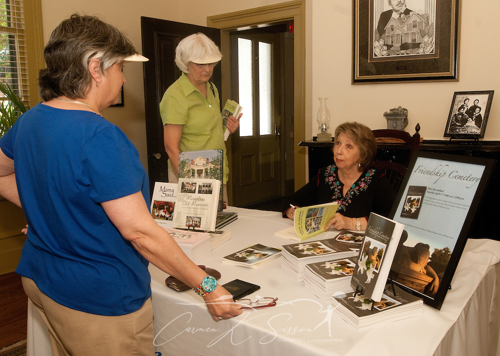 """Local author Sylvia Higginbotham (right) signs her book, """"Grits 'n Greens and Deep South Things"""" for fans during a book signing at the Tennessee Williams Welcome Center in Columbus, Miss. April 17, 2010. (Photo by Carmen K. Sisson/Cloudybright)"""