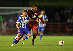 James Tilley ( L ) of Brighton and Hove Albion is challenged by Simon Walton of Crawley Town - Mandatory by-line: Paul Terry/JMP - 22/07/2015 - SPORT - FOOTBALL - Crawley,England - Broadfield Stadium - Crawley Town v Brighton and Hove Albion - Pre-Season Friendly