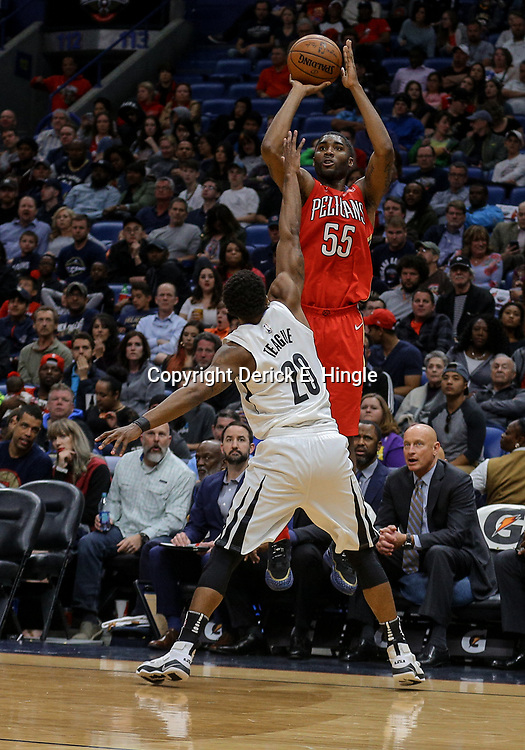 Apr 4, 2018; New Orleans, LA, USA; New Orleans Pelicans forward E'Twaun Moore (55) shoots over Memphis Grizzlies guard Marquis Teague (20) during the second half at the Smoothie King Center. The Pelicans defeated the Grizzlies 123-95. Mandatory Credit: Derick E. Hingle-USA TODAY Sports