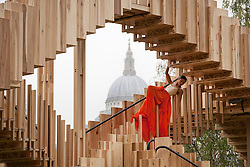 © Licensed to London News Pictures. 13/09/2013. London, UK. A dancers performs at the press view for 'Endless Stair' in London today (13/09/2013). The temporary art installation, erected outside the Tate Modern to launch national design week, was created by dRMM Architects and inspired by M C Escher's surreal drawings of never-ending staircases. Photo credit: Matt Cetti-Roberts/LNP