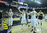 January 14, 2011: Iowa Hawkeyes guard Matt Gatens (5), Iowa Hawkeyes guard/forward Eric May (25), and Iowa Hawkeyes forward Andrew Brommer (20) celebrate their win after the NCAA basketball game between the Michigan Wolverines and the Iowa Hawkeyes at Carver-Hawkeye Arena in Iowa City, Iowa on Saturday, January 14, 2011. Iowa defeated Michigan 75-59.