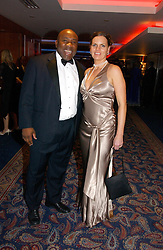 Former England rugby player VICTOR UBOGU and his wife ANJ at the Boodles Boxing Ball in aid of the sports charity Sparks  organised by Jez lawson, James Amos and Charlie Gilkes held at The Royal Lancaster Hotel, Lancaster Terrae London W2 on 3rd June 2006.<br /> <br /> NON EXCLUSIVE - WORLD RIGHTS