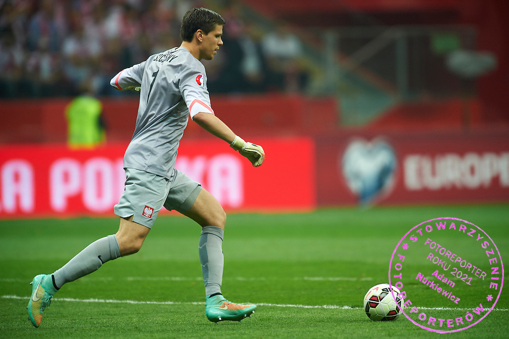 Poland's goalkeeper Wojciech Szczesny controls the ball during the EURO 2016 qualifying match between Poland and Germany on October 11, 2014 at the National stadium in Warsaw, Poland<br /> <br /> Picture also available in RAW (NEF) or TIFF format on special request.<br /> <br /> For editorial use only. Any commercial or promotional use requires permission.<br /> <br /> Mandatory credit:<br /> Photo by &copy; Adam Nurkiewicz / Mediasport