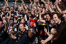 Motorsports / Formula 1: World Championship 2010, GP of Brazil,  team of Red Bull Racing celebrates constructors' champions 2010, 05 Sebastian Vettel (GER, Red Bull Racing), 06 Mark Webber (AUS, Red Bull Racing),   Christian Horner (GBR, Teamchef Red Bull Racing),