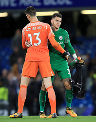 Manchester City goalkeeper Ederson greets Chelsea goalkeeper Thibaut Courtois after the final whistle during the Premier League match at Stamford Bridge, London.