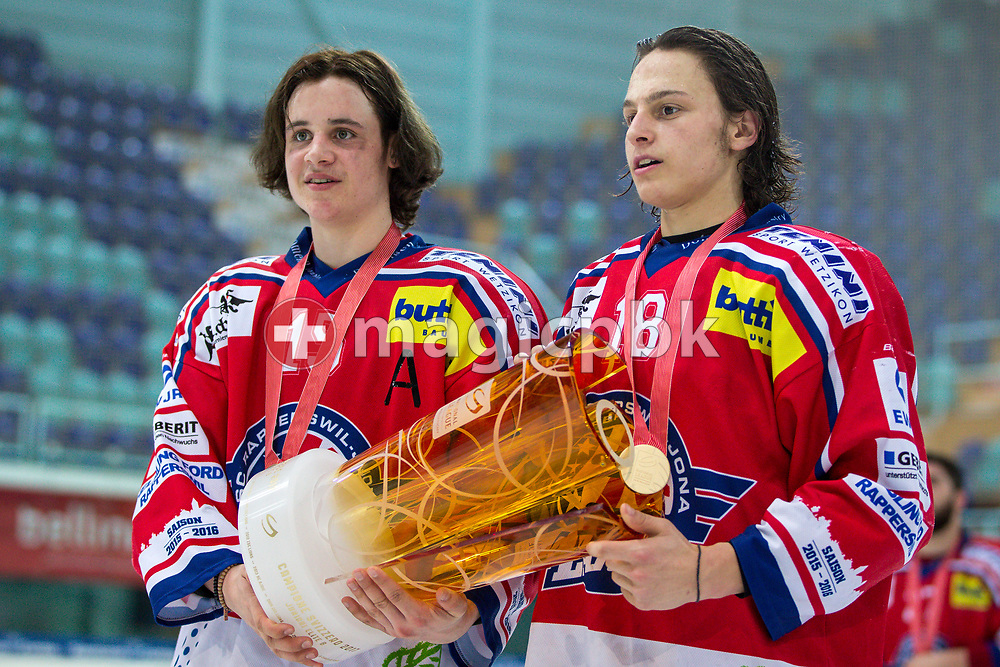(L-R) Rapperswil-Jona Lakers players Manuel Laimbacher and Toni Szabo pose for a photo with their gold medals and the Swiss Championships trophy after winning the fifth Elite B Playoff Final ice hockey game between Rapperswil-Jona Lakers and ZSC Lions held at the SGKB Arena in Rapperswil, Switzerland, Sunday, Mar. 19, 2017. (Photo by Patrick B. Kraemer / MAGICPBK)