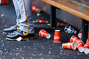 ST. LOUIS, MO - JUNE 30: A Pittsburgh Pirates player steps on one of many cups laying on the dugout floor during the game against the St. Louis Cardinals at Busch Stadium on June 30, 2012 in St. Louis, Missouri. The Pirates won 7-3 as temperatures reached 103 degrees during the game. (Photo by Joe Robbins)