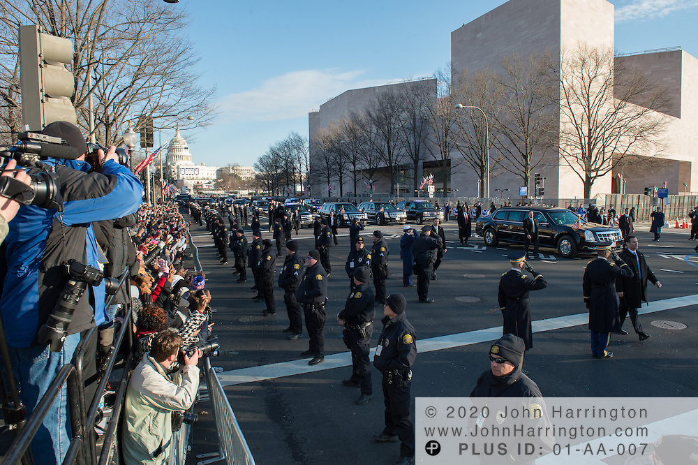 The Presidential motorcade processing down the parade route during the 57th Presidential Inauguration of President Barack Obama at the U.S. Capitol Building in Washington, DC January 21, 2013.