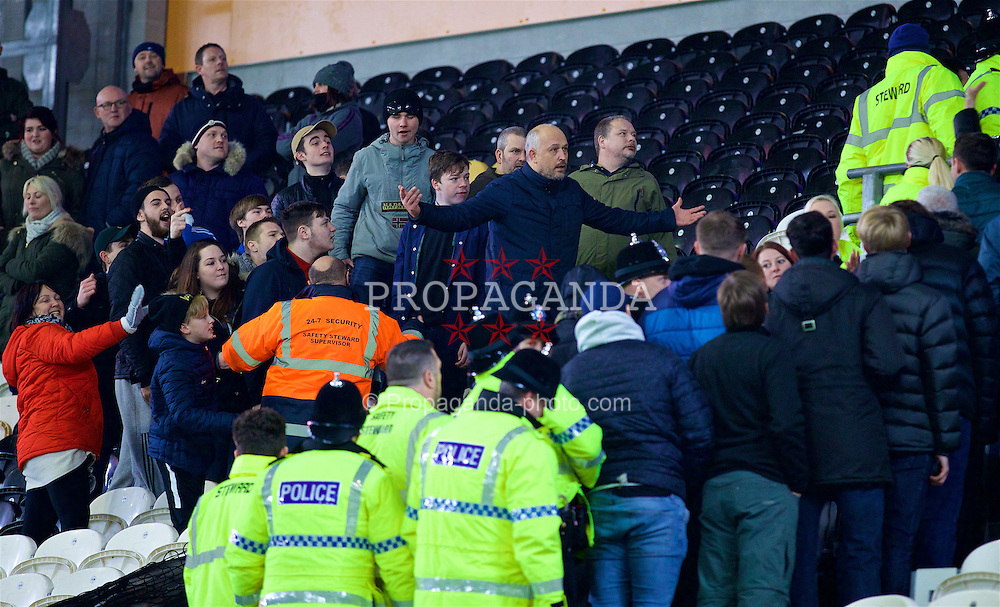 KINGSTON-UPON-HULL, ENGLAND - Friday, December 30, 2016: An angry Hull City supporter gestures to the travelling Everton supporters during the FA Premier League match at the KCOM Stadium. (Pic by David Rawcliffe/Propaganda)