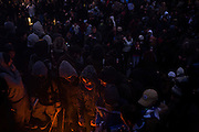 Young students and small fire during protest against government education cuts in Trafalgar Square. Holding a variety of splinter marches that denounce the coalition government's policy of charging extra higher-education tuition fees. There were isolated incidents of violence and skirmishes with police, mostly in central London.