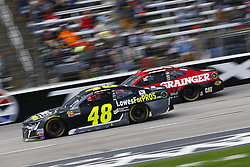 April 8, 2018 - Ft. Worth, Texas, United States of America - April 08, 2018 - Ft. Worth, Texas, USA: Jimmie Johnson (48) and Ryan Newman (31) battle for position during the O'Reilly Auto Parts 500 at Texas Motor Speedway in Ft. Worth, Texas. (Credit Image: © Chris Owens Asp Inc/ASP via ZUMA Wire)