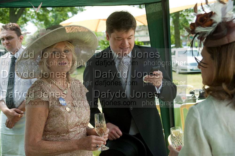 LIZ BREWER; GEORGE PISKOVA, Lunch part hosted by Liz Brewer and Mrs. George Piskova in No; 1 car-park. . Royal Ascot. Tuesday. 14 June 2011. <br /> <br />  , -DO NOT ARCHIVE-&copy; Copyright Photograph by Dafydd Jones. 248 Clapham Rd. London SW9 0PZ. Tel 0207 820 0771. www.dafjones.com.