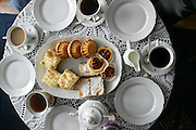 Although Hubert Sobczynski of Konstancin-Jeziorna, Poland is a professional sushi chef, he cooks and serves European fare for family and guests. Shown here are coffee and pastries at the Sobczynscy apartment. Hungry Planet: What the World Eats (p. 251).